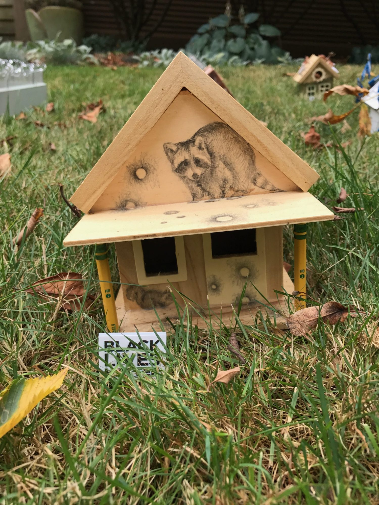 bird house with pencil drawings by julie cowan